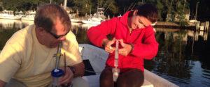 2 people taking Water Monitor Sampling
