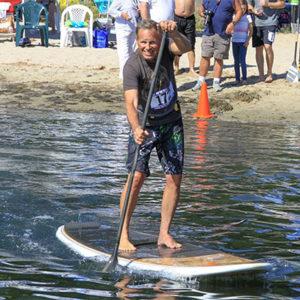 guy paddle boarding