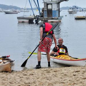 kayakers race